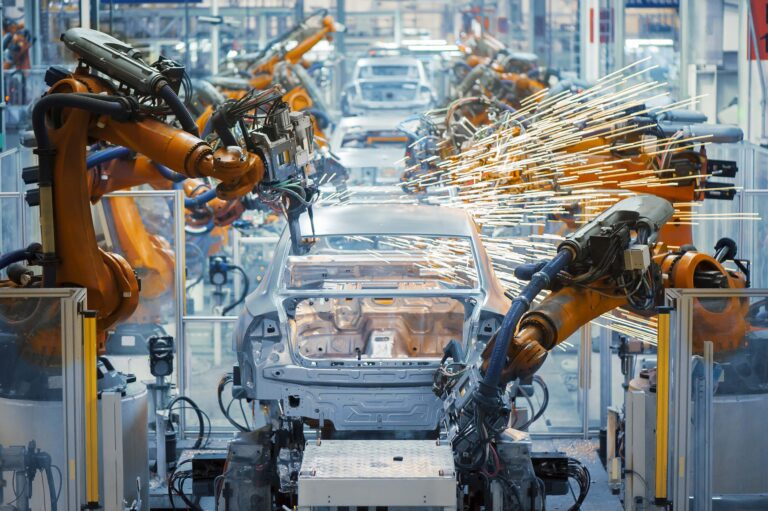 Advanced industrial robots used in an automobile manufacturing facility
