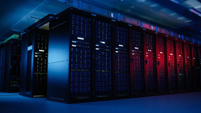 Modern datacenter with rows upon rows of server racks and enterprise servers