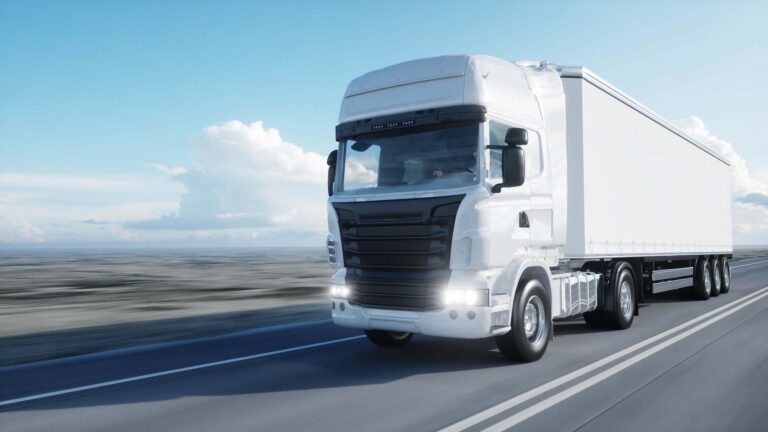 Photo of a European truck driving on a desolate road