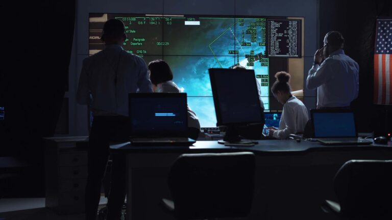 Mission control team ensuring the successful completion of a mission in space