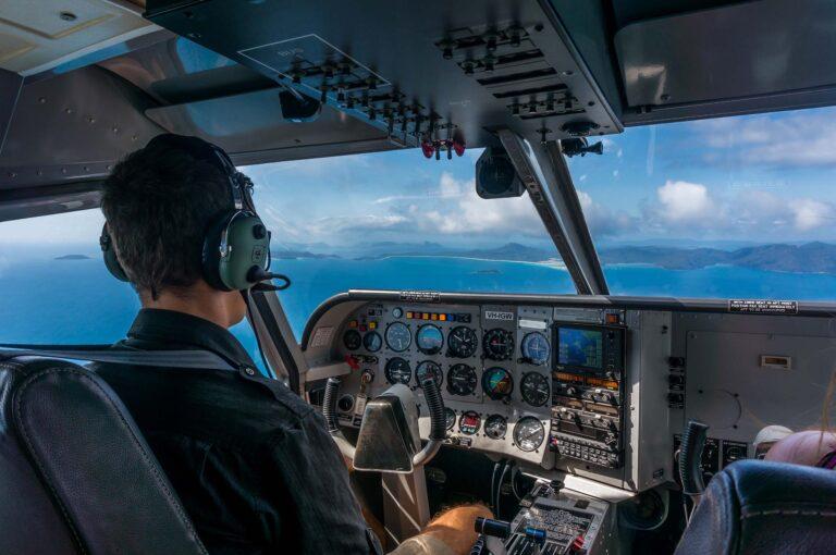 Pilot navigating his aircraft in a tropical archipelago