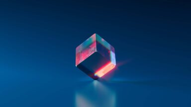 Image depicting a dice-like piece of glass getting hit with light