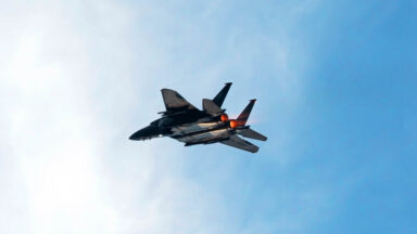 Image featuring a fighter jet using its afterburner